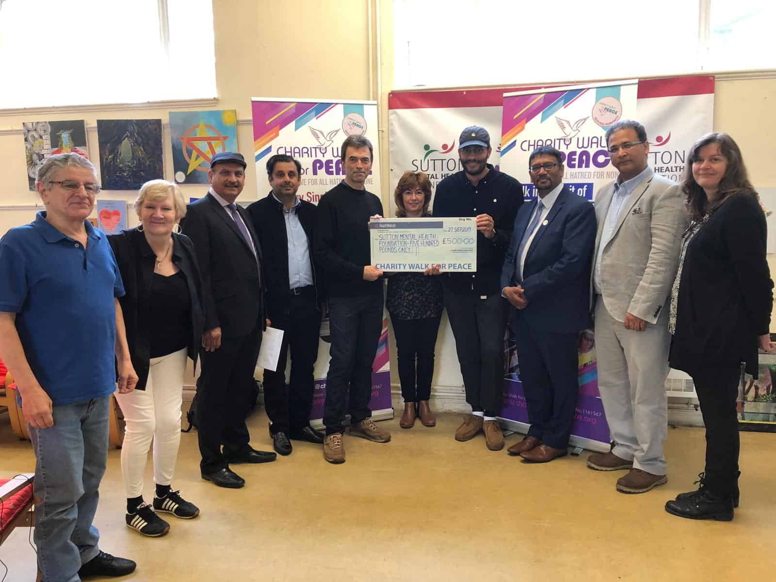 Charity Walk for Peace present Sutton Mental Health Foundation with £500.00 cheque